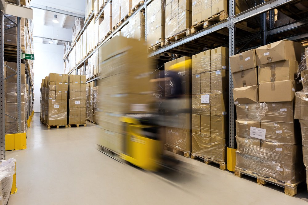 Fork lift operator preparing products for shipment quickly
